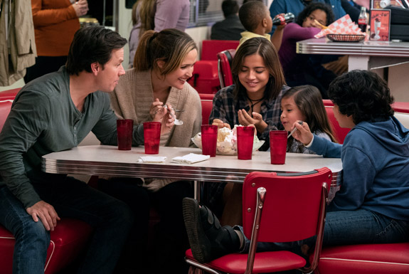 Mark Wahlberg, Rose Byrne and three children they adopt eating at a diner.